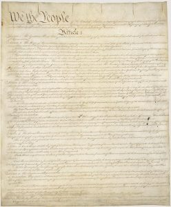 Pictured here is the first page of the U.S. Constitution. All four pages of the document are on permanent display at the National Archives. Photograph courtesy of the National Archives.