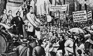 Abraham Lincoln speaks as Stephen Douglas looks on in during one of their seven debates in the 1858 campaign for Illinois senatorship. Image courtesy of NY Public Library Picture Collection/AP.